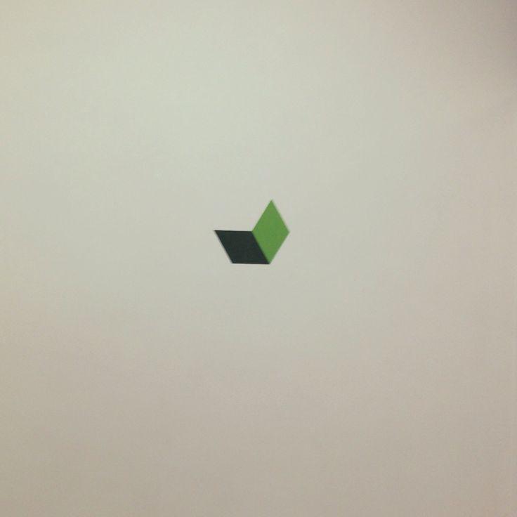 Green graphic work in progress - spray stencil on wall