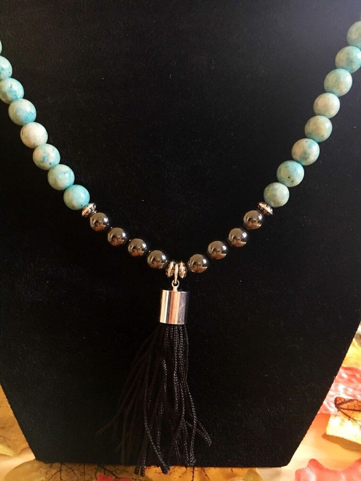 A personal favourite from my Etsy shop https://www.etsy.com/uk/listing/280120528/3-colour-necklace-of-green-chrysocolla