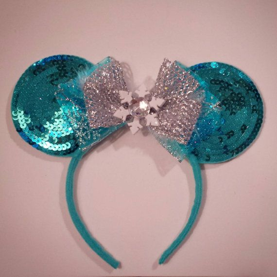 Check out this item in my Etsy shop https://www.etsy.com/listing/209980960/custom-elsa-frozen-mouse-ears