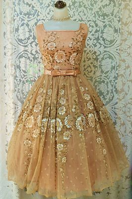 .To have lived in this era where women actually dressed like this and didn't feel silly.Beautiful pink 1950s party dress.