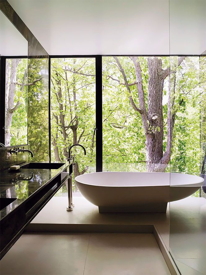 Open bathroom with a forest view is an excellent choice for those who like to be close to nature, even at home. Minimalist interior decorated in white and black colors together with large glazing blends in perfectly with the surroundings. We dream about a moment of relaxation in this bathroom. How about you?  Fot. why-i-design.tumblr.com