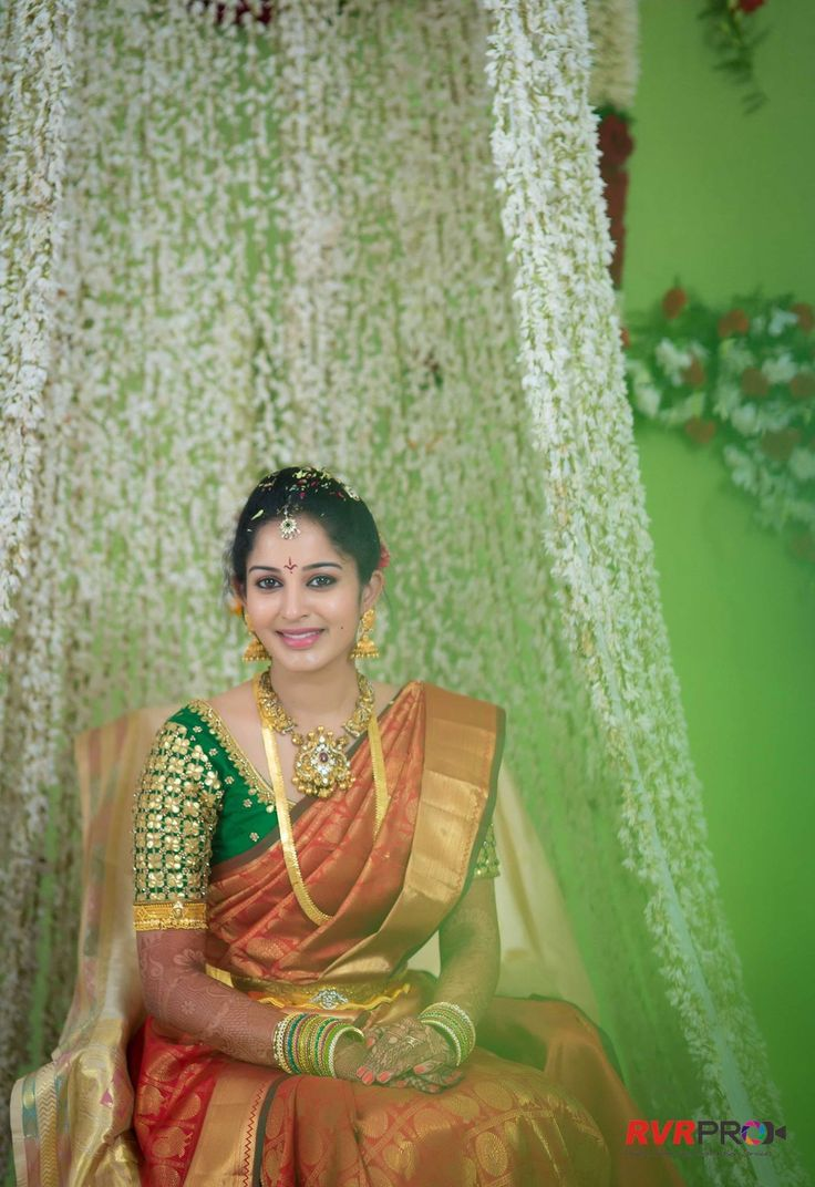 South Indian bride. Gold Indian bridal jewelry.Temple jewelry. Jhumkis. Red silk kanchipuram sari with contrast green blouse.Braid with fresh jasmine flowers. Tamil bride. Telugu bride. Kannada bride. Hindu bride. Malayalee bride.Kerala bride.South Indian wedding.