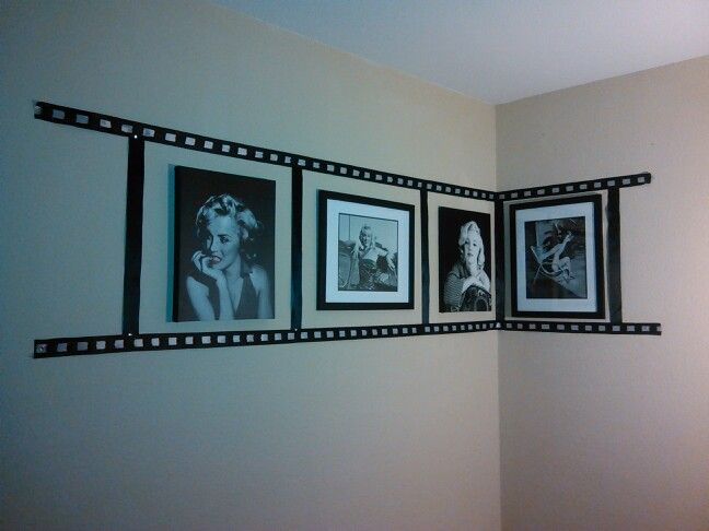 Photo reel collage made with black and white ribbon and a few of my fav Marilyn Monroe picture frames... Gives an amazing look in my living room next to my other collections!