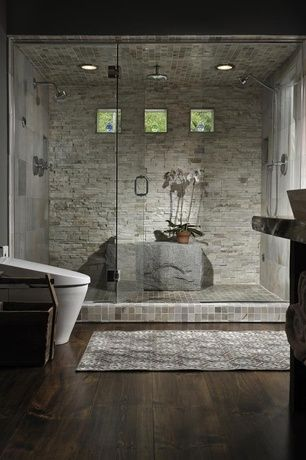 Contemporary Master Bathroom with Hardwood floors, picture window, Standard height, can lights, Built-in bookshelf, Area rug