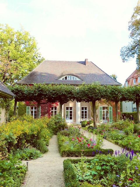just adorable    formal garden and cottage
