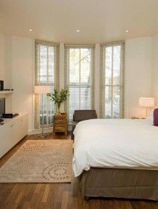Bedroom of a serviced apartments in london. So, comfortable with fluffy pillows and blanket!!