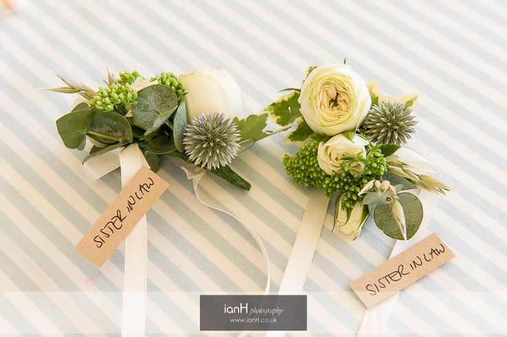 Buttonholes for beach wedding guests, by Arcade Flowers © ianH photography - www.ianH.co.uk