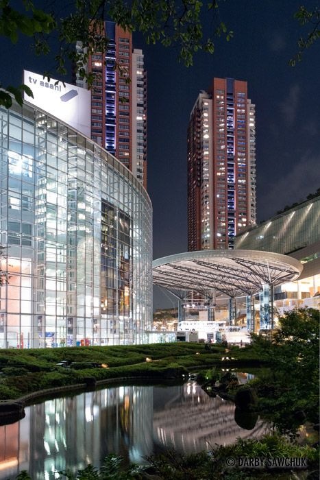 Modern buildings including the TV Asahi building light up the traditional landscape of Mori Garden in Roppongi hills, Tokyo, Japan.