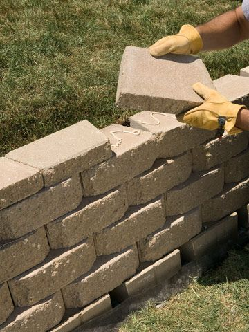 Building an interlocking retaining wall in yard | Tiered landscape brick wall idea | Put on caps | tash bkyd