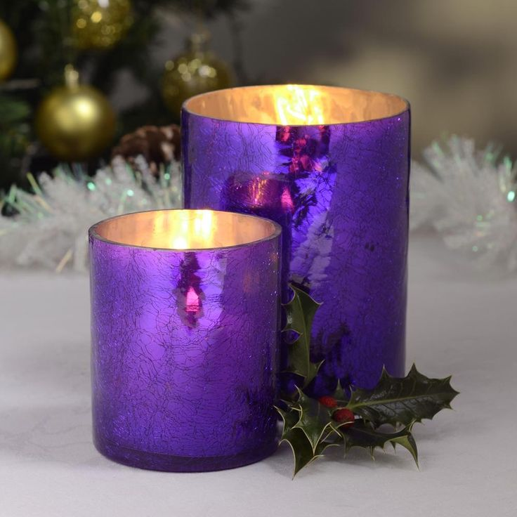 purple candle holders w/holly leaf
