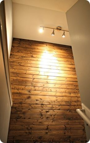stained planked wall: $9 for 6 sheets of pine planks at Lowes great for a finished basement or den