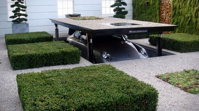 Store your car in a underground James Bond fashion and doubles your parking space. Can fit two cars - Cardok