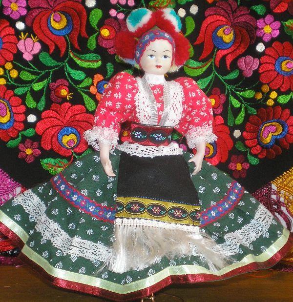 A beautiful china doll from Mezőkövesd, Hungary, dressed up in Matyó style.