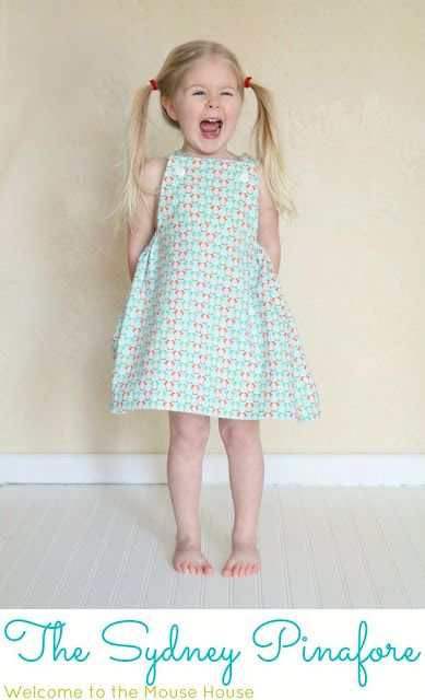 The Sydney Pinafore from Hayley at Welcome to the Mouse House, via Sew,Mama,Sew! Blog. This cute pinafore goes completely around the waist with elastic at the sides, and can be worn like a sundress, as Hayley says is common in her native Australia.
