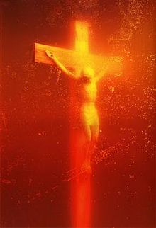 Piss Christ is a 1987 photograph by the American artist and photographer Andres Serrano. It depicts a small plastic crucifix submerged in a glass of the artist's urine.