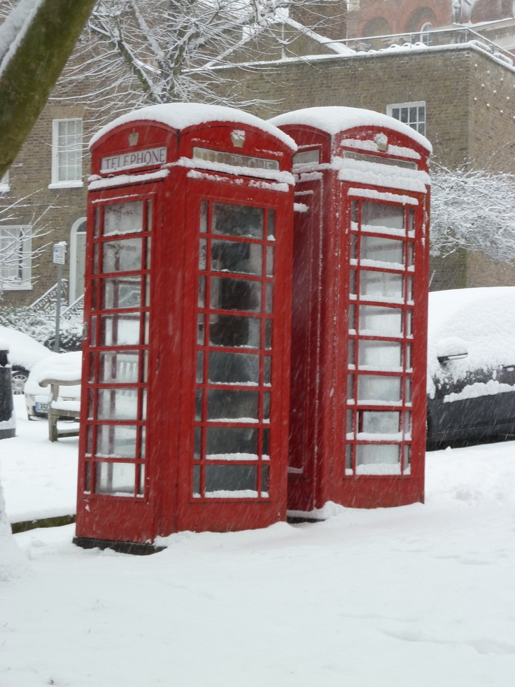 Phone Boxes on Flask Walk, Hampstead in the snow.
