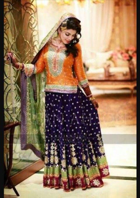 Pakistani bride dress orange purple