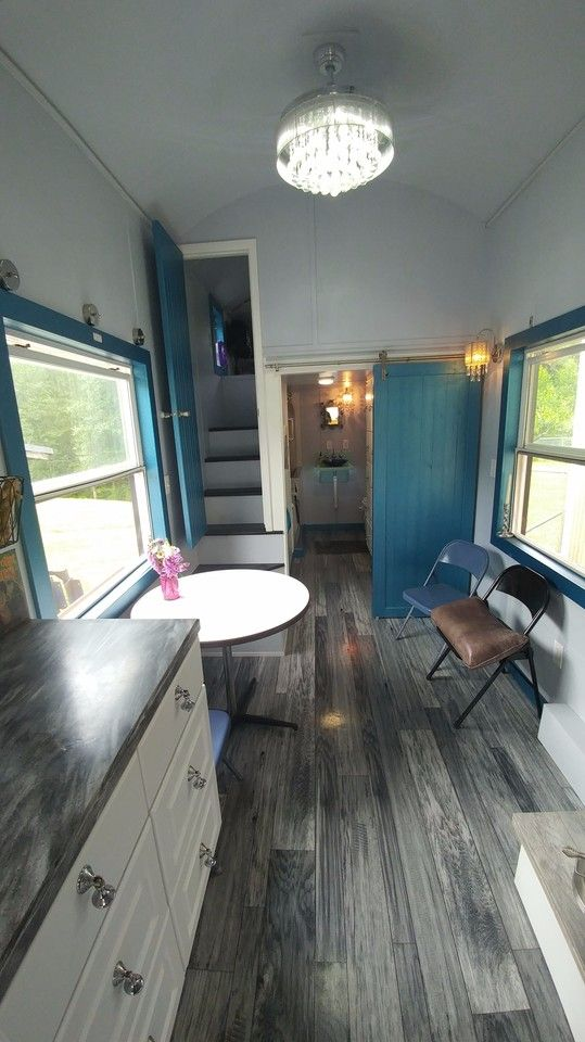 """This is Carmen, Tim and Lauren's lived-in French Storybook THOW that they had built for them by Tiny Idahomes. We shared """"just off the lot"""" pictures of the house earlier this year…"""