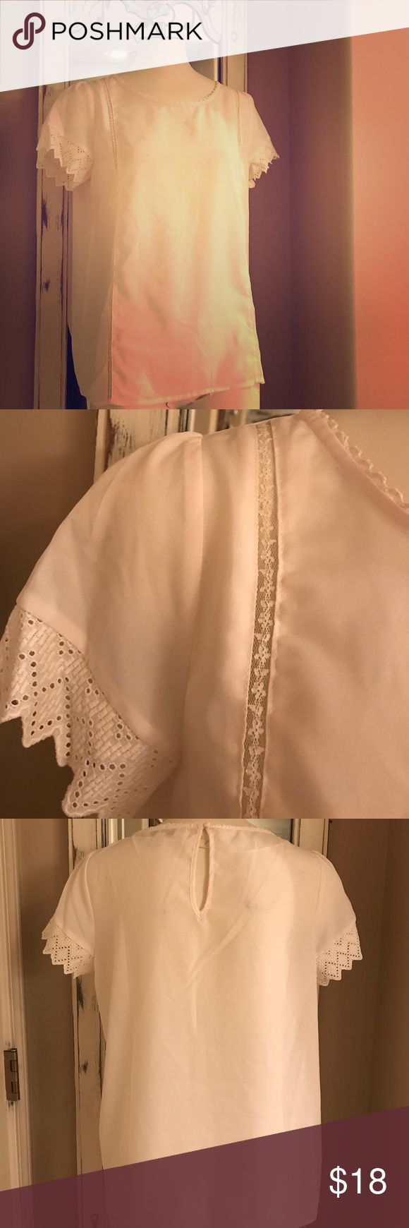 Lauren Conrad lace & sleeve top Sz:M Lauren Conrad lace detail & sleeve top Sz:M Ivory/white color. Looks to be in perfect condition. I don't see any visual flaws but unless otherwise noted all of my items are used. This seems to have never been worn & in perfect, like new condition from what is see! Gorgeous!!!  Marking as white because if it's ivory it's very light ivory but looks white to me! LC Lauren Conrad Tops Blouses