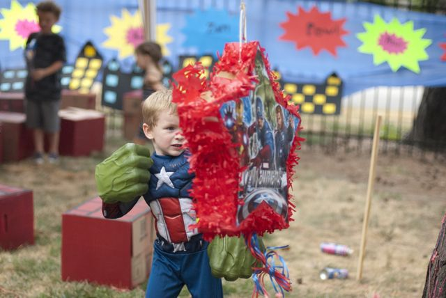 A little twist was that each kid took turns punching the pinata with the Hulk hands rather than using a stick