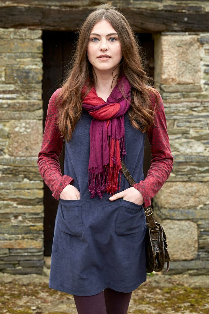 Your wardrobe staple this season, this plain cord pinafore dress comes in baltic blue and shark grey. Cosy cord with side zip and front pouch pockets. The shape is designed perfectly to layer over our plain and printed long sleeve t-shirts.