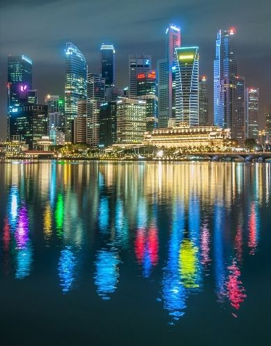 Singapore: The Marina Bay waterfront at night (Photo by: Prachanart Viriyaraks) | Singapore Photo Guide   I'll be visiting here in feb 2015!