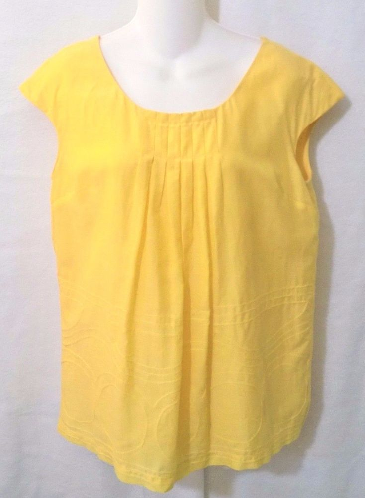 #Vince 70% #cotton and 30% #silk blend solid #yellow top #shirt #blouse with cap sleeve style, loose, flowy fit, swirly circular sewn-on design on its bottom half, full lining in a matching yellow material, pleats under neckline on front and back, matching yellow stitching/threading and darts in #womens #ladies #misses size small/S, excellent used condition…