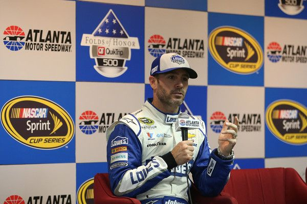 Jimmie Johnson Photos Photos - Jimmie Johnson, driver of the #48 Lowe's Chevrolet, answers questions from the media after winning the NASCAR Sprint Cup Series Folds of Honor QuikTrip 500 at Atlanta Motor Speedway on February 28, 2016 in Hampton, Georgia. - NASCAR Sprint Cup Series Folds of Honor QuikTrip 500