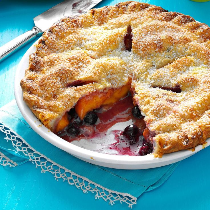 "Peach Blueberry Pie Recipe -""What a flavor!"" That's what I hear most often after folks try this pie I invented one day when I was short of peaches for a full crust. —Sue Thumma, Shepherd, Michigan"