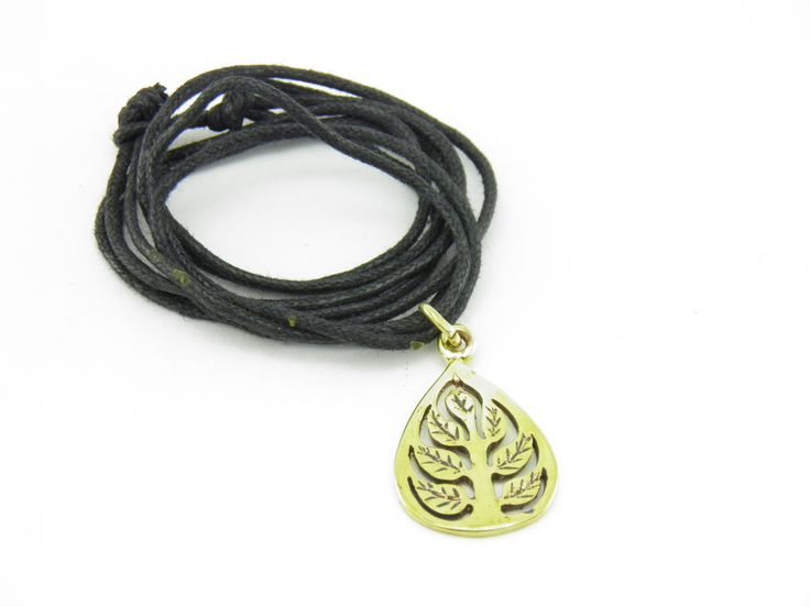"""""""Transforming violence in beauty and peace!"""" Pendant Buddha Leaf molded from recycled brass from empty gun cartridges. This pendant is mounted on a black nylon cord with a knot closing."""