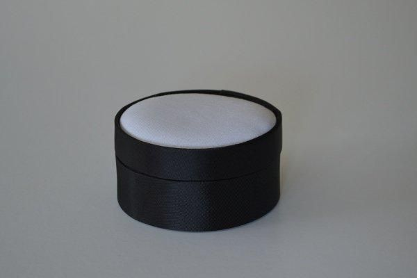 SBSrnd.42 - Small Round - Black - Satin covered and lined boxes make it so easy for you to create a special gift or precious keepsake. Embellish your fabric as you desire, cover the removable, padded lid with your worked fabric and replace into the box lid. The box measures 8.5cm in diameter.