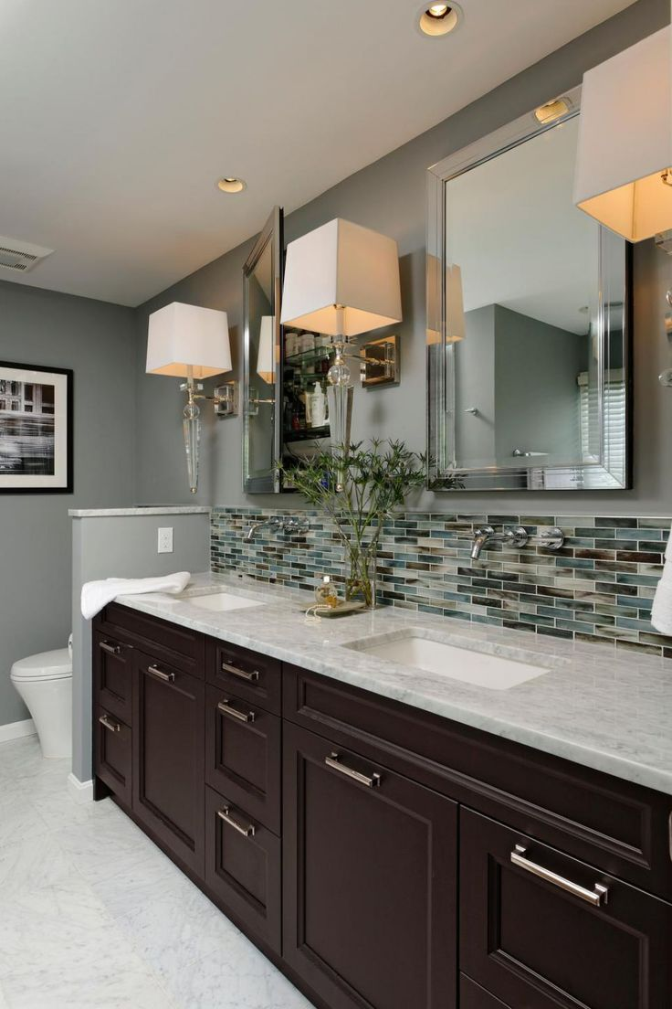 Stylish Bathroom With Wall Sconces Featured Large Shades And Mirrored Medicine Cabinets