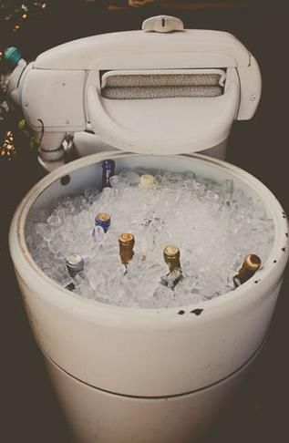 Old time hand washing machine tub as ice cooler  for country or vintage wedding.