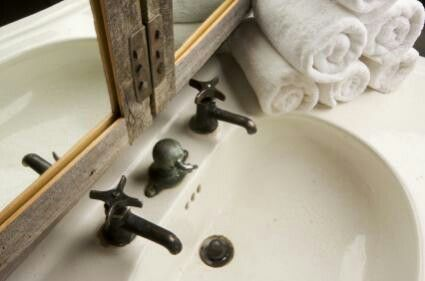 Old fashioned taps in a modern bathroom.