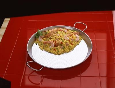 Traditional Spanish rice has enough starch and fat in one cup to sustain most people for a day or two, even though it's usually eaten as a single-serving side dish. Mock Spanish rice, however, ...
