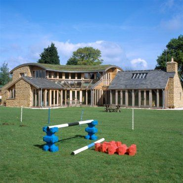 Amazing house near Oxford with Cotswold stone walls, turf roof and full height glazed oak fame