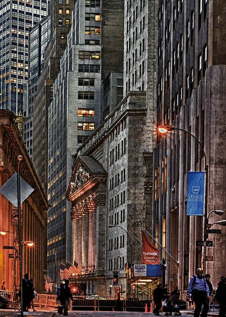 Wall Street, NYC -- the shorter building with pillars on the right side of the street is  the NY Stock Exchange