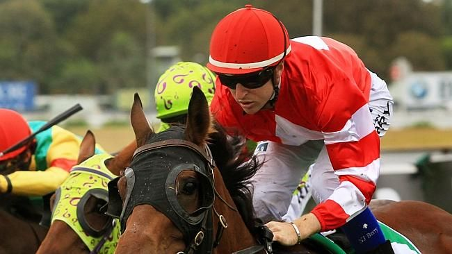 Nathan Berry wins race 2 on Hot Commodity during Randwick midweek races on the Kensington