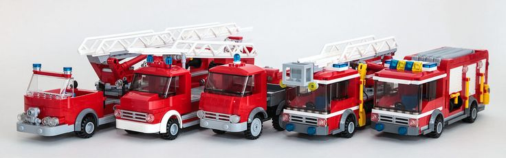 I moved to an extremely dreary cubicle that needed some color -- what better way to cheer it up than a bunch of bright red fire trucks? Also, the project was kind of on fire, so it seemed appropriate.  The first three are an experiment to put vintage fire trucks on standard LEGO City 6-wide chasis (wheels, wheel wells, etc.). The last two are rebuilds of official sets.  For more photos of these trucks see: -- Hook and Ladder Truck -- Ladder Truck and Trailer (Mercedes L322) -- Small Fire…