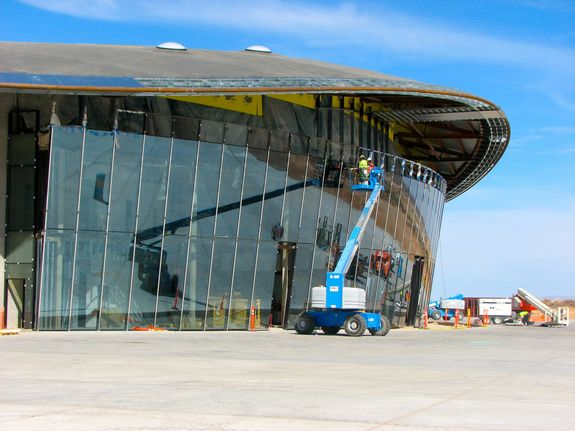 At New Mexico's Spaceport America, the planned home port of Virgin Galactic's SpaceShipTwo fleet for suborbital space tourist flights, work is nearing completion on the facility's Terminal Hangar.