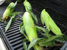 Easy and coolest way to cook corn on the cob.  Soak in their husk in water for at least 20 minutes.  Place on grill.  Cook about 20-25 minutes turning every 5 minutes. Remove from grill, cut the bottom of the ear off, squeeze the top and the corn cob will slide out without a trace of a single silk!  It really works!