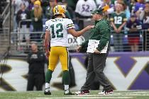 Aaron Rodgers talks with coach Mike McCarthy in the closing minutes of the game. - Image credit: Reuters