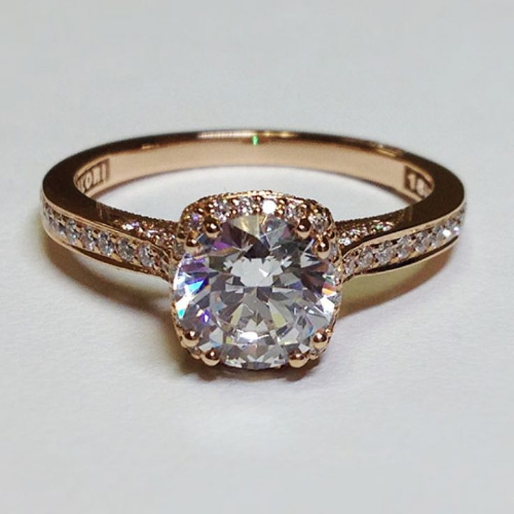 Gorgeous! Possibly a different shape diamond if not then just bigger so it pops next to the small diamonds. tacori gold engagement ring- I never wear silver anymore so if I ever get married...needs to be gold or rose gold