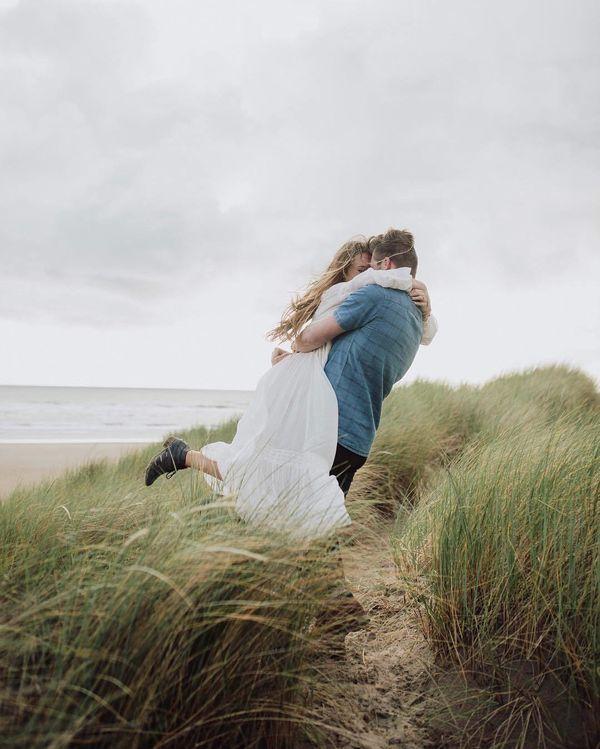 Beach Wedding Photos: With their faces hidden, the photographer has found a way to share their bliss with others without encroaching on the privacy of the couple's moment.