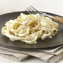 The famous Italian-inspired creamy fettuccine dish is easy to make when you use cream cheese to enrich the sauce.