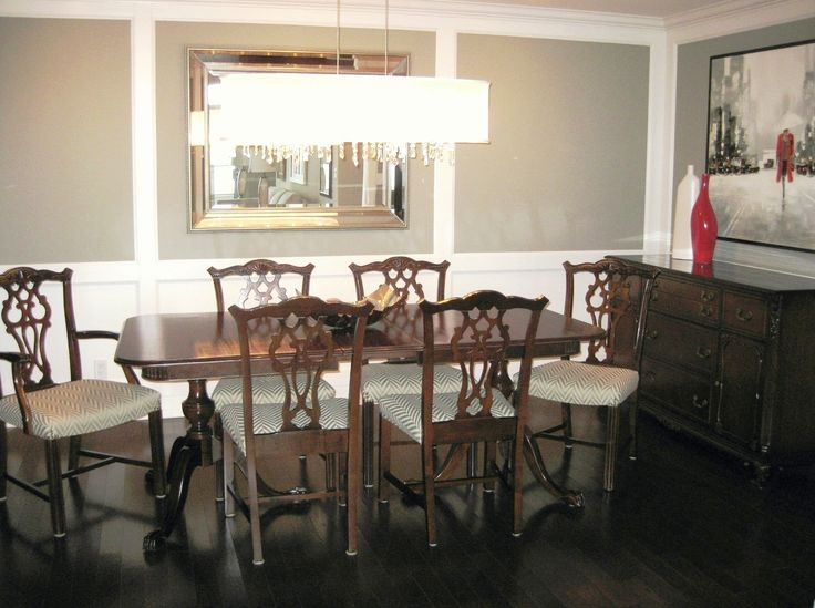This classic dinning room set was in mint condition and is still well used today. We created large open panels of wainscotting, to this windowless dining room, to add  more character and keep it bright.