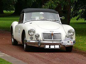 MG TF 1500 Enano y representó una ruptura completa de estilo de los coches deportivos de MG anteriores. Anunció el 26 de septiembre 1955 [3] el coche se puso en marcha oficialmente en el Salón de Frankfurt . Un total de 101,081 unidades se han vendido hasta el final de la producción en julio de 1962, la gran mayoría de los cuales fueron exportados. Solamente los 5869 coches fueron vendidos en el mercado nacional, el porcentaje más bajo de cualquier coche