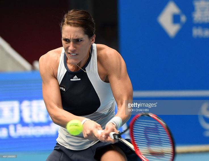 Andrea Petkovic of Germany hits a return against Eugenie Bouchard of Canada during their first round women's singles match at the China Open tennis tournament in Beijing on October 5, 2015.