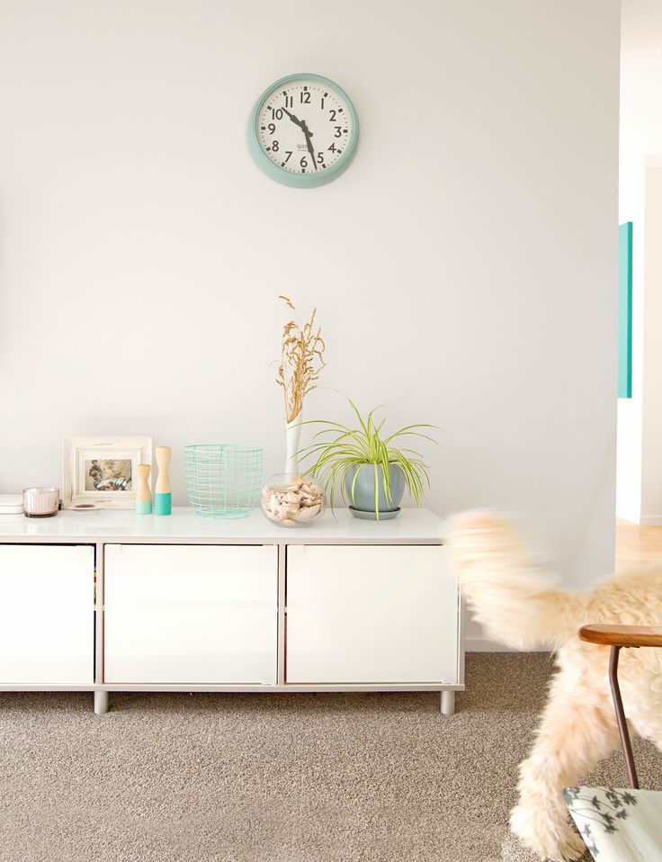 """Lisa chose to paint the whole interior in Resene 'Wan White', providing a neutral backdrop to highlight the turquoise accents used throughout. """"I like to have a neutral base that I can add colour to or swap out easily as my tastes change."""""""
