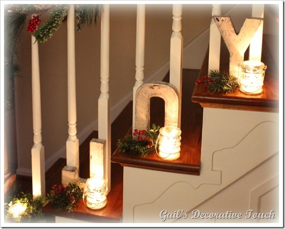 I love the use of the JOY letters, candles and greenery on this stair case! From Gail's Decorative Touch